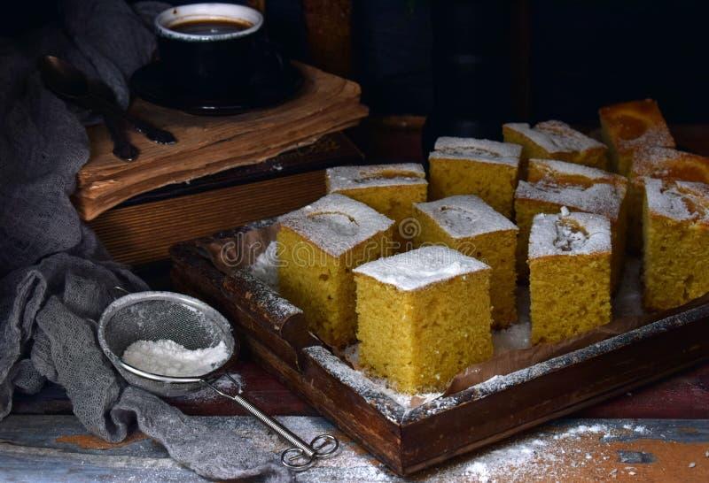 Homemade corn cake with tangerines on dark background. Traditional Brazilian sweet pie. Cornbread. Style Dark Moody royalty free stock photos