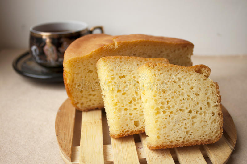 Homemade cornbread. Slices of homemade cornbread with cup of tea royalty free stock photography