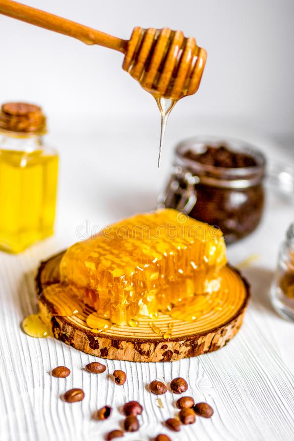 Homemade cosmetics based on honey and coffe. Wooden background royalty free stock images