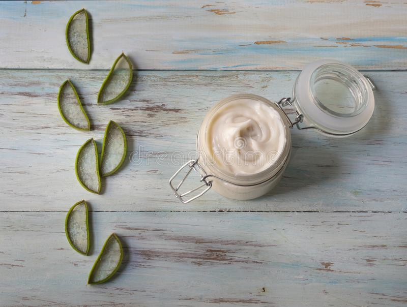 Homemade cream of Aloe Vera in a glass jar, with cut aloe vera stock images