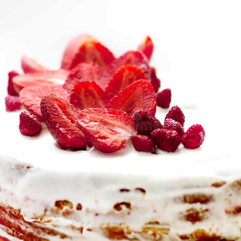 Homemade cream cake with strawberries. Homemade summer dessert on white rustic table, high angle view stock image