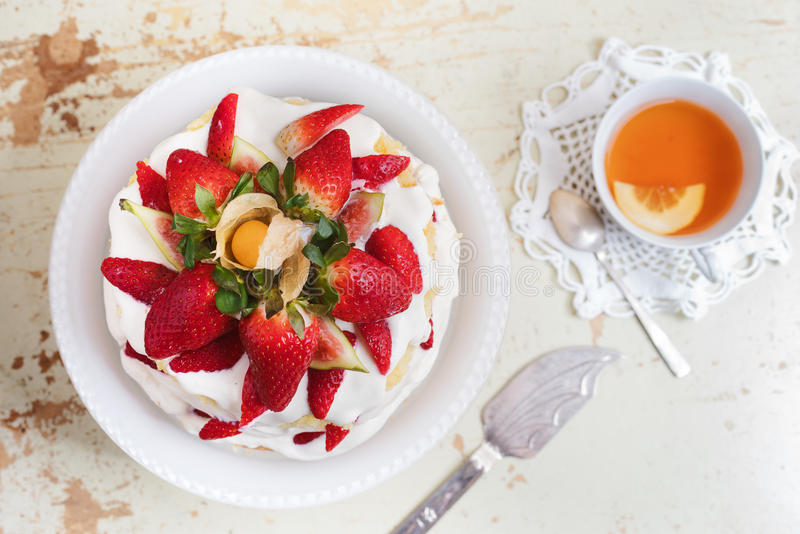 Homemade cream layer cake, fresh, colorful, and delicious dessert with juicy strawberries, sweet whipped cream and cream cheese. Selective focus. Space for stock photos