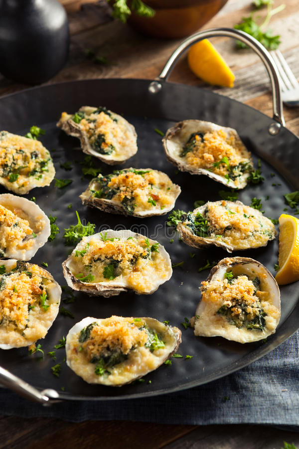 Homemade Creamy Oysters Rockefeller. With Cheese and Spinach royalty free stock photo
