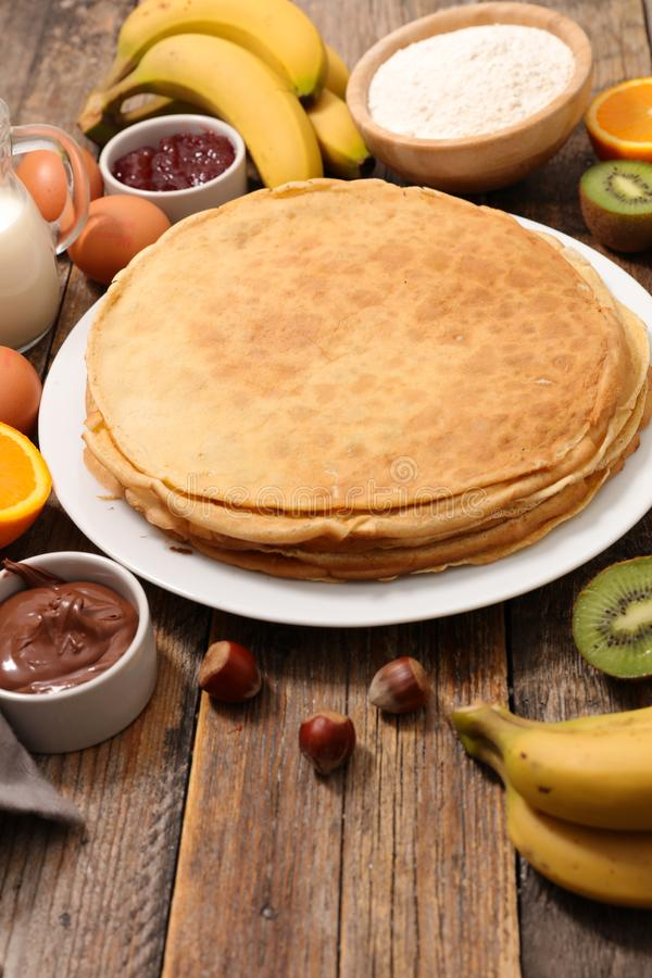 Homemade crepe and fruit. On wood royalty free stock photo