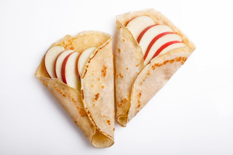 Homemade Crepes With Apple. Couple of homemade crepes with organic apples stock photos