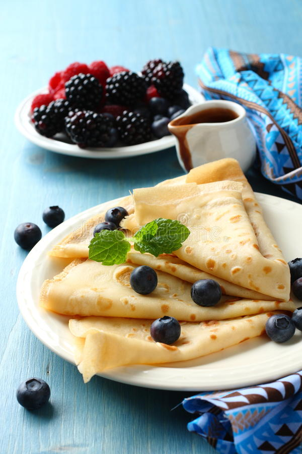 Homemade crepes with blueberries, chocolate sauce stock photo
