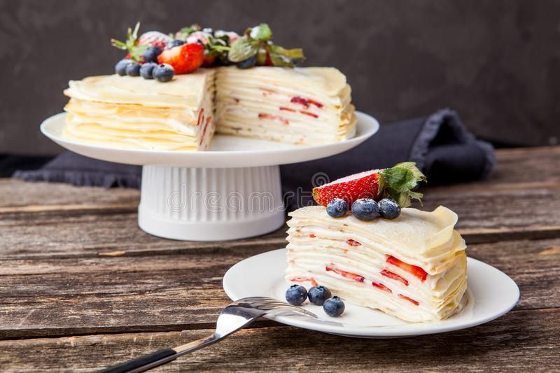 Crepes cake with cottage cheese and strawberry, selective focus. Homemade crepes cake with strawberry on rustic background. Cooking fresh homemade breakfast stock photos