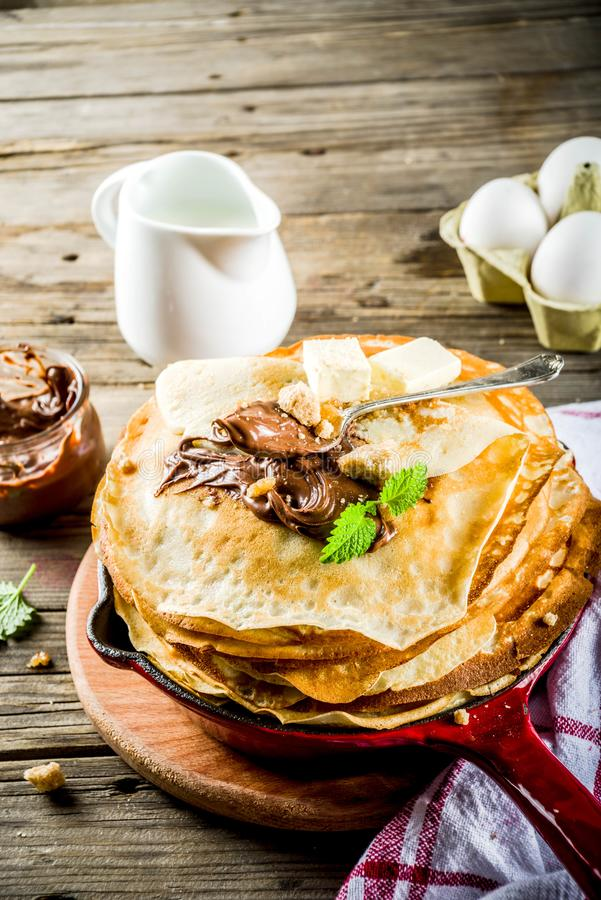 Homemade crepes with chocolate sauce stock photos