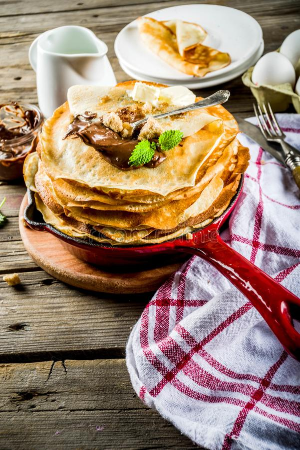 Homemade crepes with chocolate sauce royalty free stock image