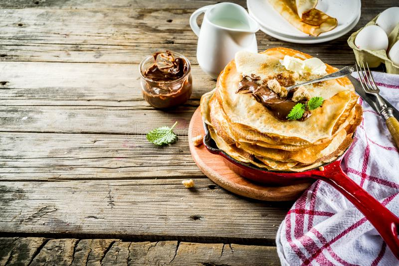 Homemade crepes with chocolate sauce stock photography