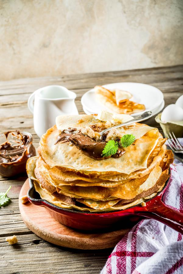 Homemade crepes with chocolate sauce royalty free stock images