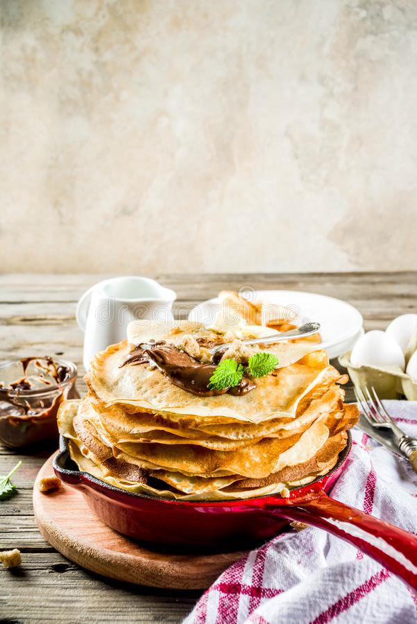 Homemade crepes with chocolate sauce. Russian and ukrainian thin pancakes bliny, rustic wooden background copy space stock images