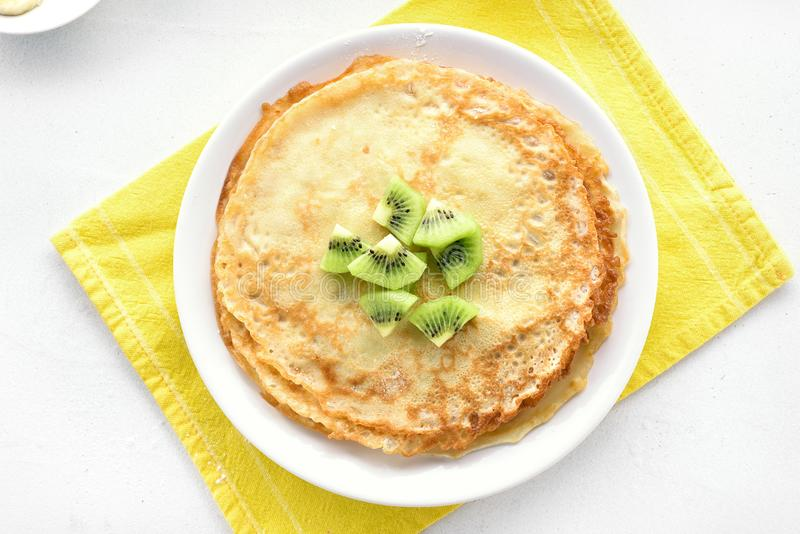 Homemade crepes decorated with kiwi slices stock photo