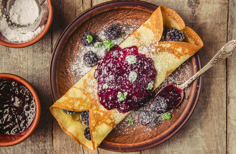 Homemade crepes with honey. Homemade crepes with jam. Selective focus royalty free stock photography