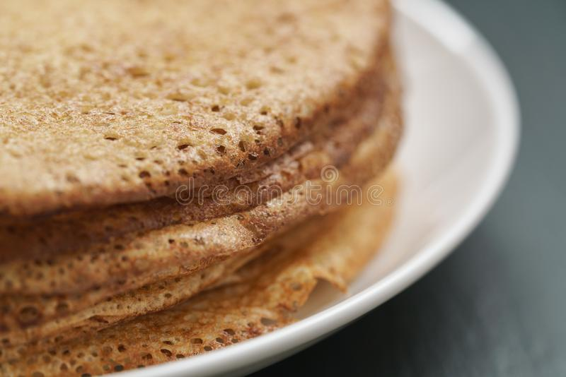 Homemade crepes on plate on slate board. Shallow focus royalty free stock photography