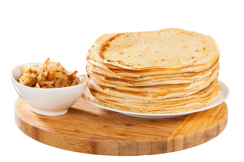Homemade crepes. With pork on white background royalty free stock photos