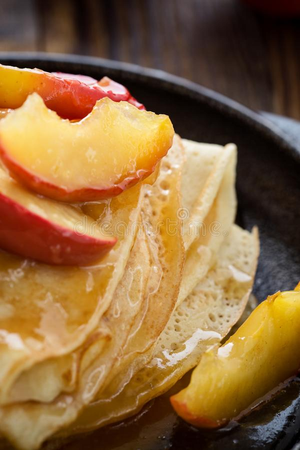 Homemade crepes served with caramelized apples royalty free stock images