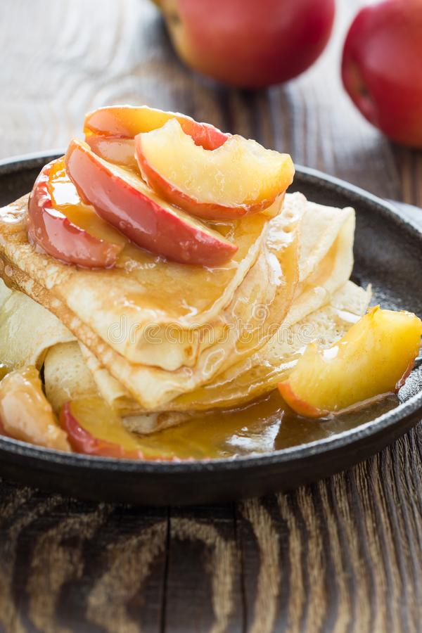 Homemade crepes served with caramelized apples royalty free stock image