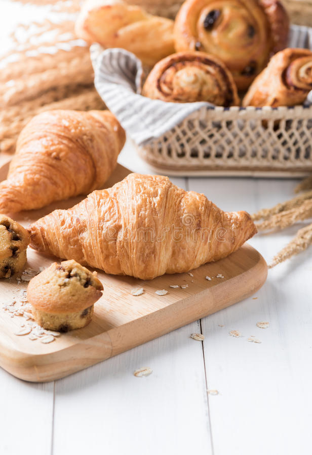 Homemade croissant on white wood background. Breakfast food royalty free stock image