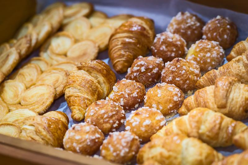 Homemade Croissants. Box of breakfast pastries. Two wooden trays, flaky croissants, and apple danishes stock photography