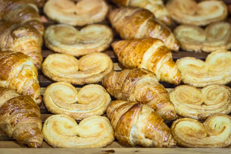 Homemade Croissants. Box of breakfast pastries. Two wooden trays, flaky croissants, and apple danishes stock image