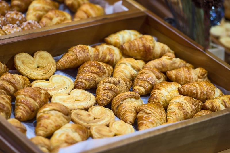 Homemade Croissants. Box of breakfast pastries. Two wooden trays, flaky croissants, and apple danishes stock photo
