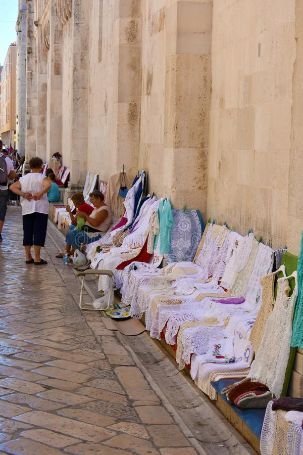 Homemade crotchet table-clothes and doilies. Women sell homemade crochet clothes and table-clothes and doilies in the streets of Zadar, Croatia stock photography