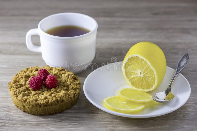 Homemade  crumbly shortbread with a cup of tea. The concept of home tea, light snack royalty free stock photos