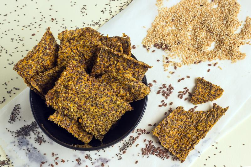Homemade crunchy bread from flax seeds, Chia, sesame and carrots. Concept-healthy food, vegetarianism, raw food. royalty free stock photo
