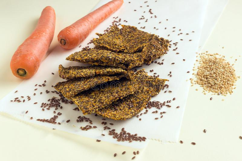 Homemade crunchy bread from flax seeds, Chia, sesame and carrots. Concept-healthy food, vegetarianism, raw food. stock photos