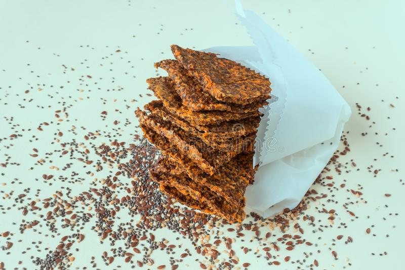 Homemade crunchy bread from flax seeds, Chia, sesame and carrots. Concept-healthy food, vegetarianism, raw food. stock image