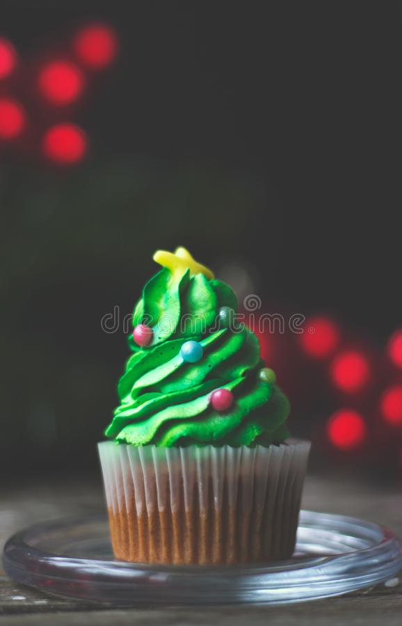 Homemade cupcake decorated as christmas tree; christmas or new y. Ear background with copy space stock photo
