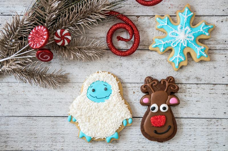 Homemade decorated Christmas sugar cookies in shapes of a snowflakes, reindeer and snowman stock photos