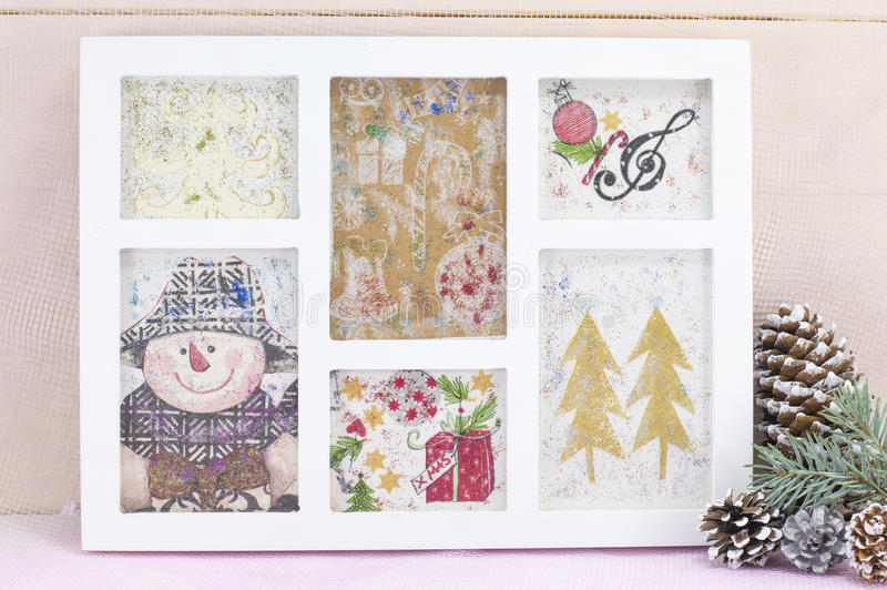 Homemade decoupage Christmas decorations in a photo frame royalty free stock photography