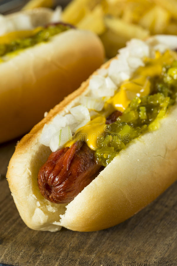 Homemade Deep Fried Hot Dogs. With Mustard Onion and Relish stock photography