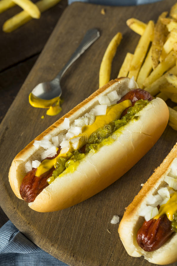 Homemade Deep Fried Hot Dogs. With Mustard Onion and Relish royalty free stock photos