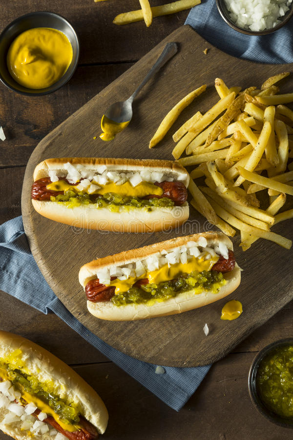 Homemade Deep Fried Hot Dogs. With Mustard Onion and Relish stock photo