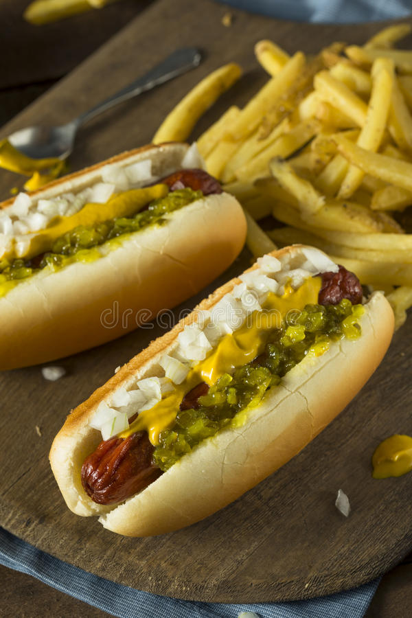 Homemade Deep Fried Hot Dogs. With Mustard Onion and Relish royalty free stock images