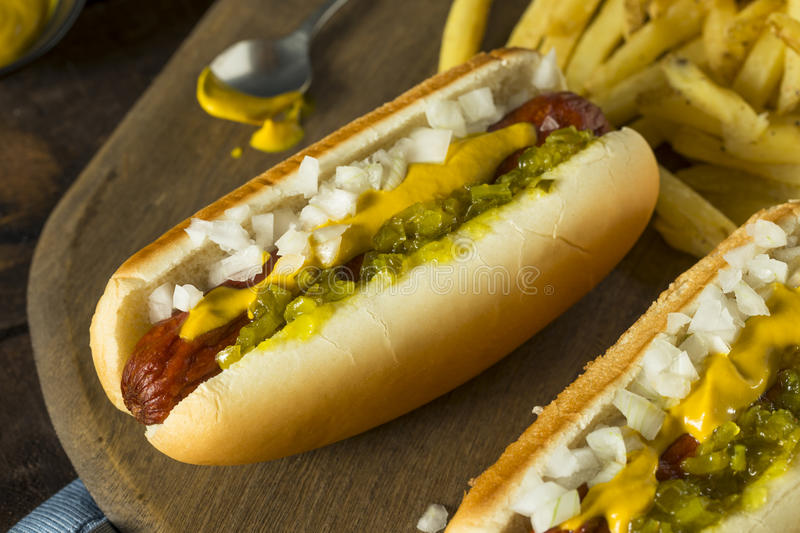 Homemade Deep Fried Hot Dogs. With Mustard Onion and Relish royalty free stock image