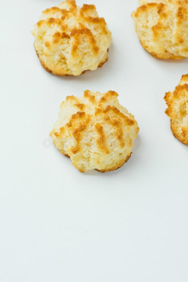 Homemade Delicious Coconut Macaroons with Golden Crust on White Kitchen Table. Christmas Pastry Baking Kids Desserts stock photos