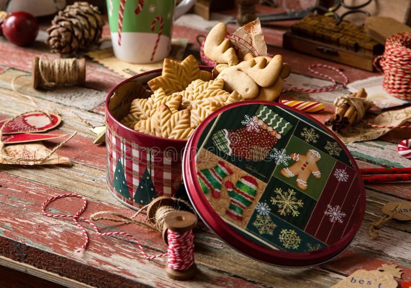 Gingerbread cookies in vintage gift round metal box with christmas ornaments. Homemade delicious gingerbread cookies in vintage gift round metal box with royalty free stock photo
