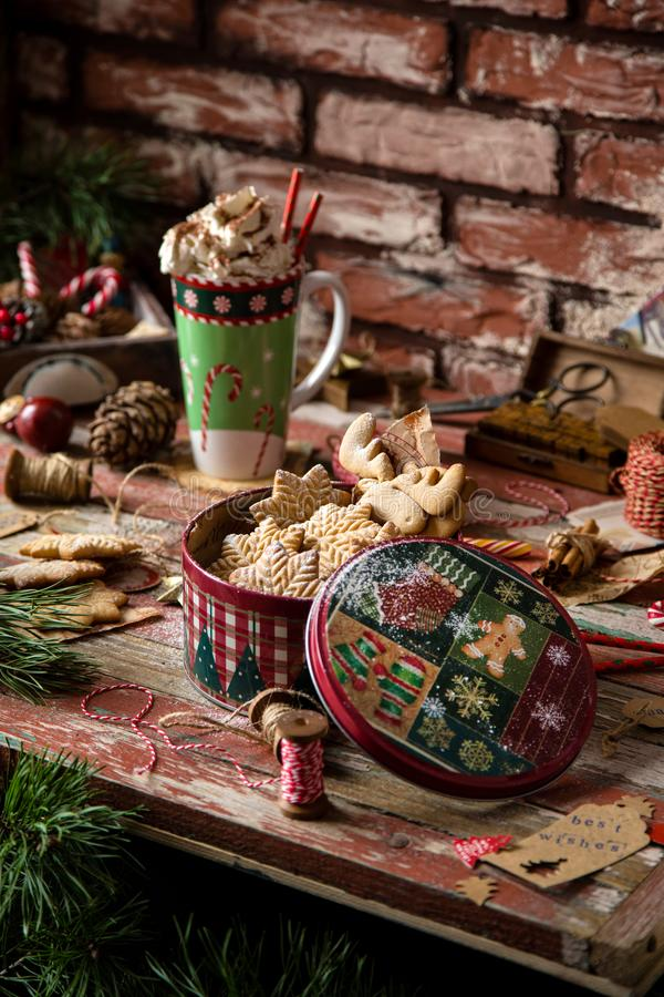 Gingerbread cookies in vintage gift round metal box with christmas ornaments. Homemade delicious gingerbread cookies in vintage gift round metal box with stock photography
