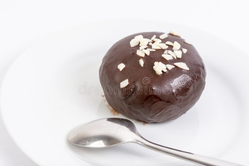 Homemade delicious and sweet round chocolate ball served on the plate. Cookie, cocoa, tasty, food, gourmet, brown, snack, dessert, milk, closeup, eat, white royalty free stock images