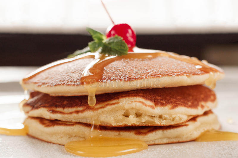 Homemade dessert. Fried pancakes with honey royalty free stock photography