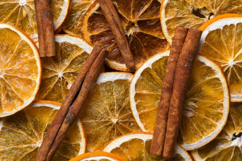 Homemade dried fruits slices of orange cinnamon sticks food pattern. New year Christmas decoration elements. Baking hot beverage ingredients. Vintage style card stock photo