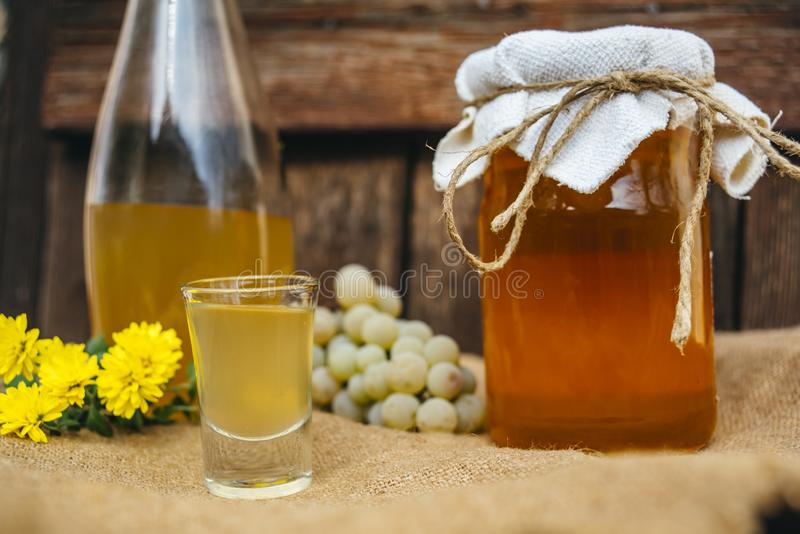 Homemade drink of brandy and honey. In small glass royalty free stock photos