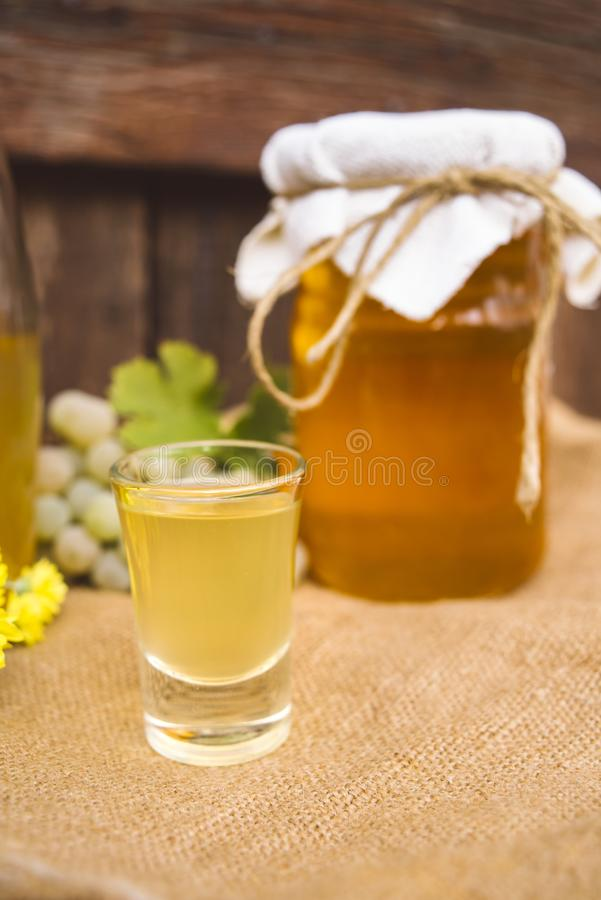 Homemade drink of brandy and honey. In small glass stock photography