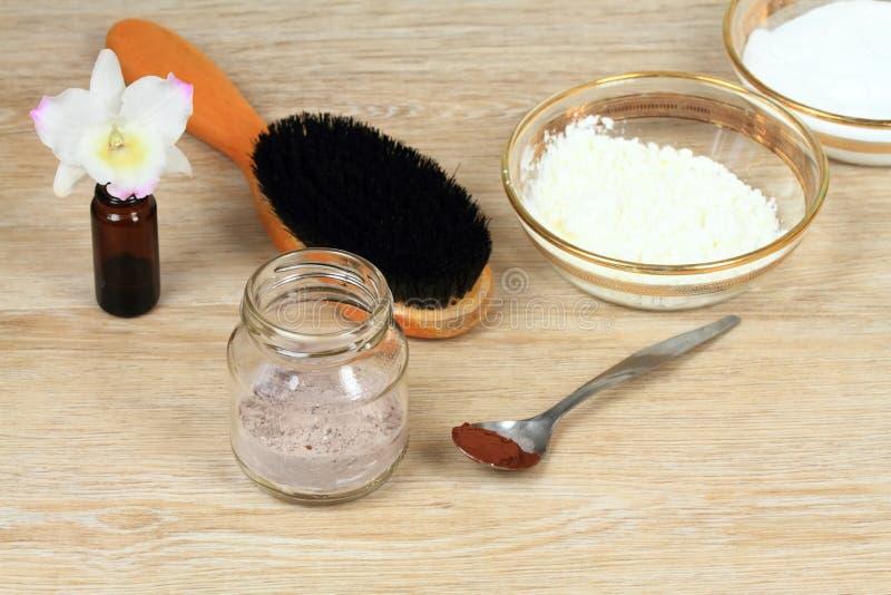 Homemade dry shampoo in a glass jar stock image