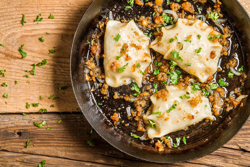 Homemade dumplings fried with onion and parsley stock image