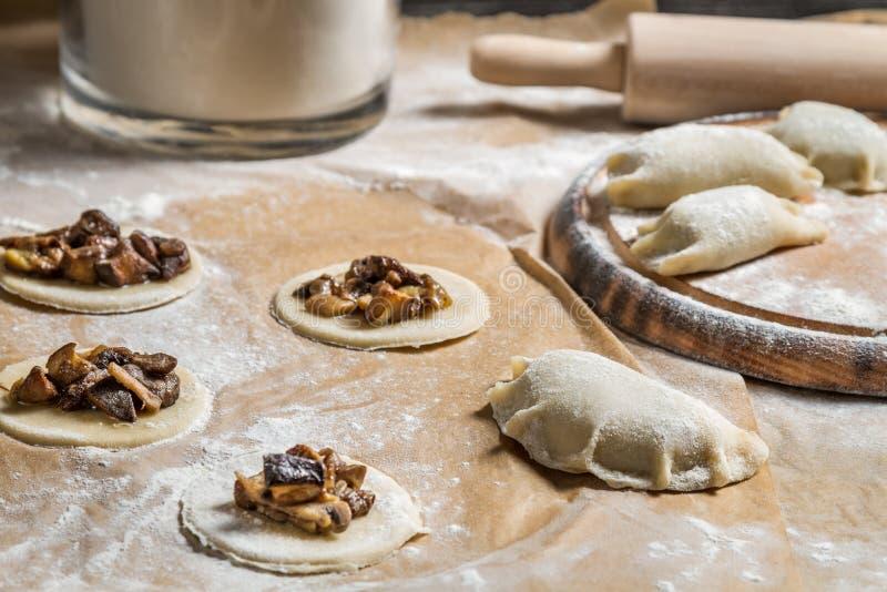 Homemade dumplings with mushrooms stock photography